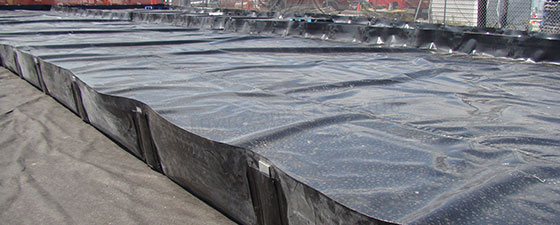 Click to learn more about spill berms and spill pans from EnviroZone in the USA